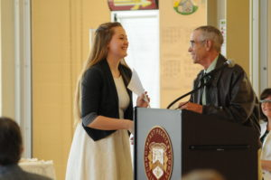 Bob Jorgensen presents the first environmental scholarship at East Peoria High School to Hannah Schroer.